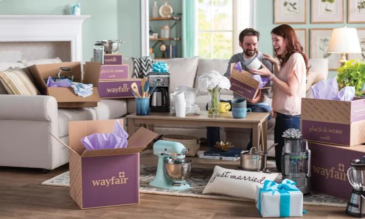 Couple opening wedding gifts